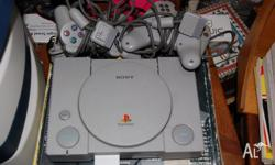 I sony playstation with 3 controllers, 1 memory card