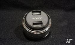 "I am selling a ""Sony SEL16F28"" wide angle pancake lens."