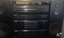 FOR SALE IS THIS OLD SCHOOL LARGE SONY STEREO WITH 6 CD