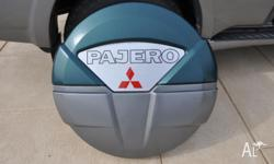 I am selling my used Pajero NP spare wheel cover. It
