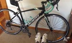 As new - Specialized Dolce 51-52 Womens Road Bike. Paid