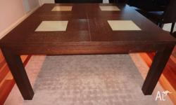 Hard wood chocolate dining table with frosted glass