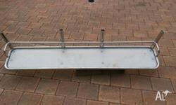 Stainless with nylon bait board. Hand made to fit
