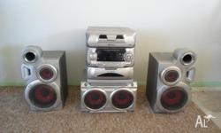 5 CD Stacker Mini Stereo. Mid-size 150w Am/Fm CD with
