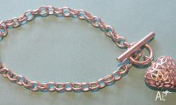 Sterling silver heart bracelet- $40. Purchased from
