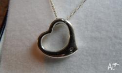 This lovely sterling silver heart shaped necklace has a