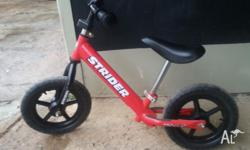 Well loved Strider balance bike for sale. My son loved