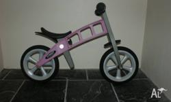 I'm selling a strider bicycle, a pink girl's bicycle