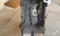 Black and grey 'Childcare' stroller. Minor damage to