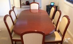 Elegant dining table plus 8 chairs for sale. The