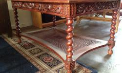 This gorgeous antique coffee table is looking for a