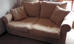 Suede sofa bed, used less than a dozen times. Was top