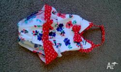 Beautiful baby girls swimsuit, never worn as our baby