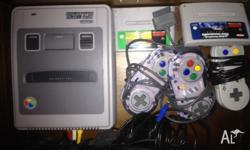 Super Nintendo with 3 controls and 2 games I have