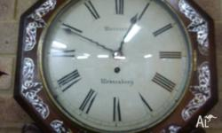 A lovely antique wallclock in Rosewood. Inlaid with