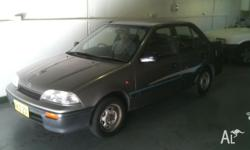 SUZUKI,SWIFT,1992, FWD, GREY trim, 4D SEDAN, 1324cc,