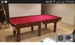 Up fpr grabs is ny solid 6 leggedslate pool table