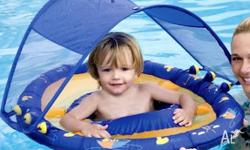 Blue inflatable swim float with sun canopy. It is in
