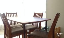 This is a wooden table and 4 chair set. It's sturdy but