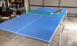 Ping pong table comes with four racquets, balls and