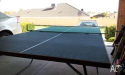 Old school blue top table tennis table and net.Top is