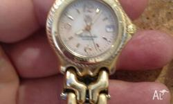Ladies Tag Heuer Solid 18ct gold case and bessel.
