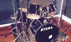 For sales is a 5 piece black Tama drum kit, used