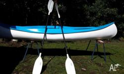 Blue & white fibreglass 10 foot canoe with 2 paddles,