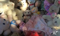 A busket full of teddy bears, one bunny, 2 piglets,