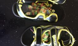 Size 13 TMNT sandals. Worn a couple of times just grew