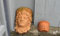 Greco/Roman ladies head terracotta wall pot....in very