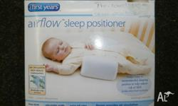 the first years airflow sleep positioner helps to keep