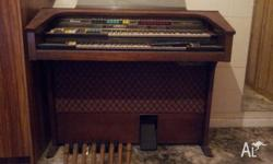 An Electric organ that was used by our children when