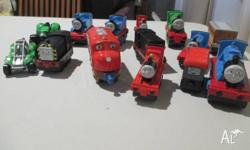 12 Thomas the Tank Engine engines and carriages and 2