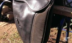Genuin thorowgood synthetic dressage saddle near new.
