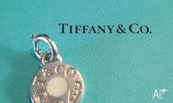 A timeless Tiffany favourite. Charm with white enamel