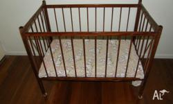 Lightweight varnished timber cot with hinged ends to