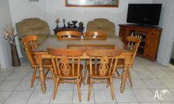 TIMBER DINING TABLE AND 6 CHAIRS HAS HAD A 7mm GLASS