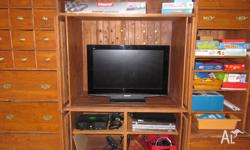 This HUGE entertainment unit is for immediate sale -