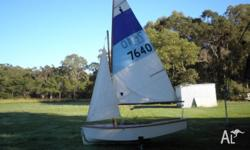 Timber gaff rigged sailing dingy in good condition on