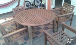 Round outdoor table with 4 chairs good condition. Has