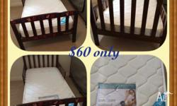Toddler bed WITH top of the line mattress . Originally