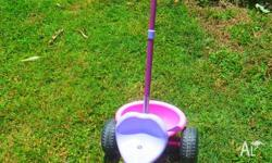 Toddler girls pink and purple pedal trike with rear