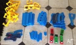 80 pieces of tomy tracks used to build many tracks for