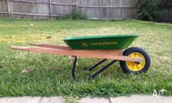 John Deere toy wheelbarrow in good condition.