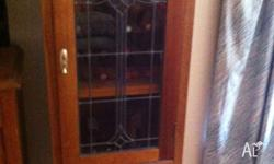 Traditional tall boy style cupboard with stained glass