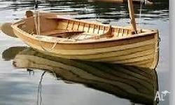 Traditionally clinker built sailing dinghy made from