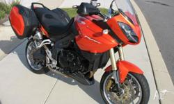 "2008 model in ""Blazing Orange"", 1050cc, 3 cyl in line,"