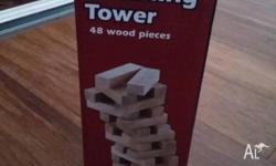 Build a tower with the 48 wood pieces and strategically