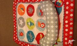 Hardly used tummy time mat